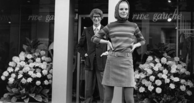 ce0dafbdda7 Yves St Laurent at his Rive Gauche boutique in Paris, with a model wearing  his