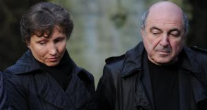 Boris Berezovsky stands at the Highgate Cemetery graveside in London of Alexander Litvinenko, accompanied by  the former security service agent's widow Marina, who has cast doubt on rumours of suicide related to the Russian oligarch's death. Photograph: Stefan Rousseau/PA Wire