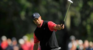 Tiger Woods   watches his putt on the ninth hole during the final round of the   Arnold Palmer Invitational tournament in Orlando, Florida. Photograph: Scott Miller/Reuters