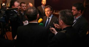 Agsi general secretary John Redmond listens as Minister for Justice Alan Shatter speaks to the media after addressing the  annual conference of the Association of Garda Sergeants and Inspectors in Sligo yesterday. Photograph:  Brian Farrell