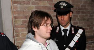 Raffaele Sollecito is escorted from a court in Perugia in 2009.  Photograph: Giuseppe Bellini/Getty Images