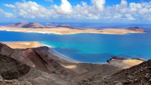 The Canary Islands: Clickandgo.com can get you to Lanzarote (above) in Puerto del Carmen from €591pps  and Gran Canaria, Las Palomas from €486pps (both self-catering). 