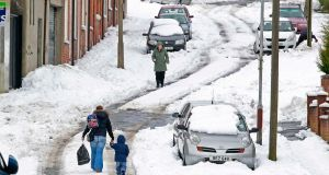 People walk through heavy snow in north Belfast  as wintry weather continues to cause havoc . Photograph: Reuters