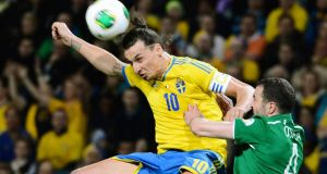Sweden's Zlatan Ibrahimovic in action against the Republic of Ireland's John O'Shea during the World Cup qualifier in Stockholm. Photograph:  Claudio Bresciani Reuters/Scanpix Sweden