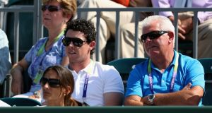 Rory McIlroy watches his girlfriend Caroline Wozniacki play tennis last week alongside his father Gerry. Photo: Clive Brunskill/Getty Images