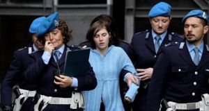 Amanda Knox is led away from Perugia's court of appeal after the first session of her appeal in November 2010. Photograph: Oli Scarff/Reuters