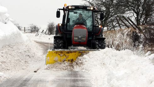 Snow ploughs clear the Carnlough to Ballymena road in Co Antrim after a heavy snowfall. Photograph: Paul Faith/PA Wire