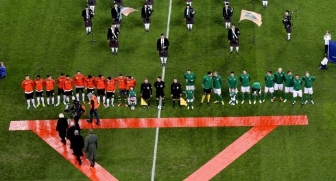 President Michael D Higgins walks on to the pitch to meet the teams ahead of kick-off. Photograph: James Crombie/Inpho.