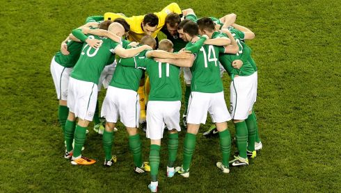 The Irish team huddle before kick-off.  Photograph: James Crombie/Inpho.