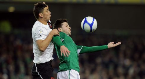 Shane Long battles for possession with Aleksander Dragovic of Austria. Photograph: Morgan Treacy/Inpho.