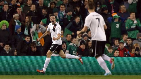 Austria's Martin Harnik celebrates his early goal as surprised Ireland fans look on. Photograph:  Donall Farmer/Inpho.