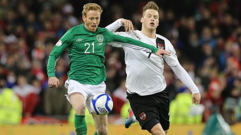 Irish substitute Paul Green and Marco Arnautovic battle for possession in the closing minutes of the game. Photograph: Lorraine O'Sullivan/Inpho.