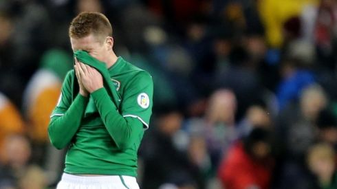 Ireland's James McCarthy shows his disappointment after the full-time whistle.    Photograph: James Crombie/Inpho.