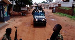 Armed fighters from the Seleka rebel alliance patrol the streets in pickup trucks to stop looting in Bangui. Photograph: Reuters