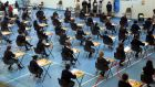 Students sitting the Leaving Cert: a review of grading bands and an external analysis of the predictability of exam papers are on the way. Photograph: Dara Mac Dónaill