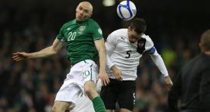 Ireland's Conor Sammon competes with Austria captain Christian Fuchs at the Aviva. Photograph: Inpho