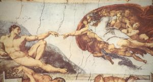 "Detail of the ceiling of the Sistine Chapel shows the ""Creation of Adam"", a panel in the massive narrarative work by Michelangelo. Photograph: Hulton Archive/Getty Images"