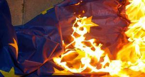 A European Union flag ablaze during an anti-bailout rally outside the presidential palace in Nicosia yesterday. Photograph: Yannis Behrakis/Reuters
