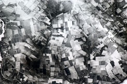 Crazed patchwork of farms in Central Asia, a monochromatic 3D hallucination in the snow. Photographs: Chris Hadfield