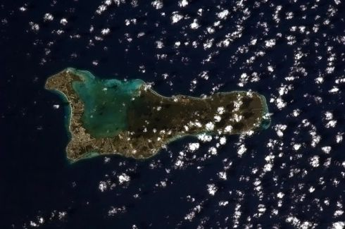 Airport, beach, coral, sunshine. A little bit of Cayman paradise. Photographs: Chris Hadfield