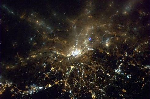 Pittsburgh, Pennsylvania, with the lights of the city piercing through the clouds. Photographs: Chris Hadfield