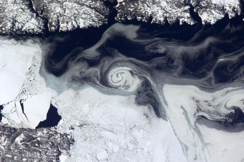 Tonight's Finale: A gyre frozen into the ice, Newfoundland, Canada.  Photographs: Chris Hadfield