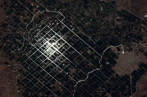 Sunglint catches the irrigation canals of these Mexican farmers. Photographs: Chris Hadfield