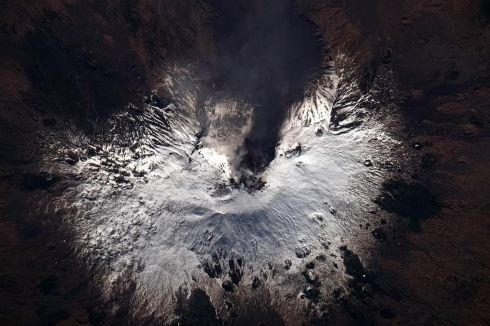 Mt Etna, pouring heat and steam and smoke up through the snowcap. Earth never ceases to amaze.  Photographs: Chris Hadfield