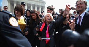"Edith Windsor (centre) is mobbed by journalists and supporters as she leaves the Supreme Court in Washington, yesterday. The court heard oral arguments in the case ""Edith Schlain Windsor"" challenging the constitutionality of the Defence of Marriage Act, the second case about same-sex marriage this week. Photograph: Chip Somodevilla/Getty Images)"