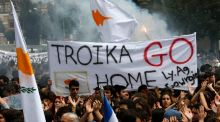 Students  take part in an anti-Troika protest outside the Presidential palace in Nicosia. Cyprus's Stock Exchange extended an almost two-week shutdown after the island placed controls on currency transactions to prevent a run on deposits when banks reopen. Photograph: Yannis Behrakis/Reuters