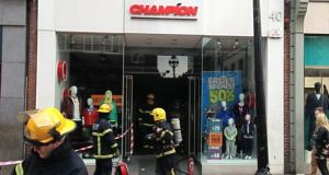 Dublin Fire Brigade personel outside the Champion Sports store. Photograph: Killian O'Sullivan