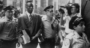 Trial by media: Yusef Salaam is escorted to court by police. Photograph: Clarence Davis/Daily News/Getty/PBS