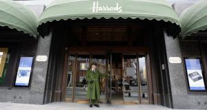 A doorman outside the Harrods department store in London. The store is a regular visiting place for tourists looking to buy luxury goods.