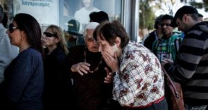 A crowd waits for a branch of Cyprus Bank to open in Nicosia, Cyprus, yesterday, after almost two weeks of closure. Photograph: Angelos Tzortzinis/The New York Times