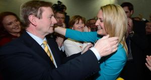 Taoiseach Enda Kenny congratulates Helen McEntee, on being elected as a TD, taking her fathers seat in the Meath East byelection, as her mother Katlhleen (Centre) watches at the count centre in Donaghmore, Ashbourne. Photograph: Alan Betson
