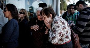 A crowd waits for a branch of Cyprus Bank to open in Nicosia. Photogaph: Angelos Tzortzinis/The New York Times