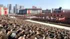 North Koreans including soldiers attend a rally in support of North Korean leader Kim Jong-un's order to put its missile units on standby in this unverified picture released by the North's official KCNA news agency today. Phot ograph: KCNA/Reuters