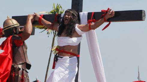 Ruben Enaje (52), who is portraying Jesus Christ for the 27th time, screams while a man playing a Roman soldier pulls out a nail from his palm after he was nailed on a wooden cross during a Good Friday crucifixion re-enactment in Pampanga province, north of Manila ,in the Philippines. Photograph: Romeo Ranoco/Reuters