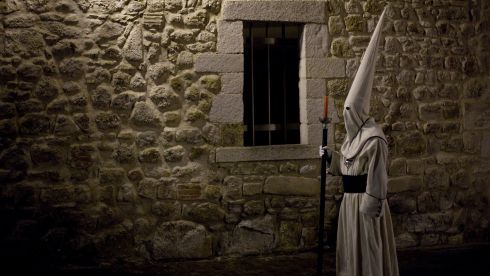 A penitent stands during the Holy Week procession of the Cofradia Jesus Yacente in Zamora, Spain. Photograph: Pablo Blazquez Dominguez/Getty Images
