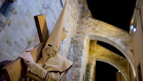 A penitent carries a cross in Zamora, Spain. Photograph: Pablo Blazquez Dominguez/Getty Images