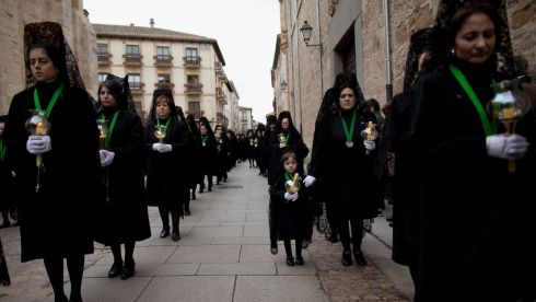 Womens, wearing  mantillas, walk the streets in Zamora, Spain.  Photograph; Pablo Blazquez Dominguez/Getty Images