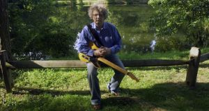 Paul Muldoon with his guitar in Princeton, New Jersey, in 2007. Photograph: Oliver Morris/Getty Images