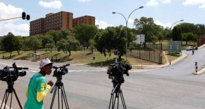 Members of the media are seen outside the One Military Hospital, which former South African President Nelson Mandela was previously admitted into, in Pretoria. Photograph :Siphiwe Sibeko/Reuters