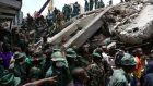 Rescuers search for survivors amongst the rubble of a collapsed building in the Kariakoo district of central Dar es Salaam. Photograph: Emmanuel Herman/Reuters