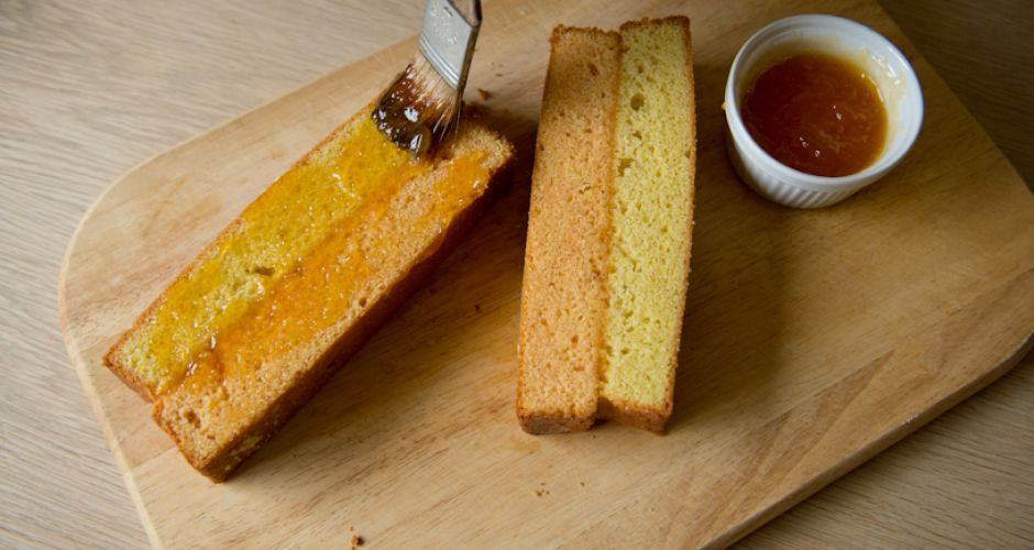 Cut the cake lengthwise down the centre. Brush the cut sides with jam ...