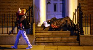 "A homeless man sleeping on Kildare St in Dublin. ""Great disparities in wealth and power divide society into the rich and the poor."" Photograph: Dara Mac Dónaill/The Irish Times"