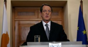 Cypriot president Nicos Anastasiades addresses the nation with a televised speech from the presidential palace in Nicosia in the wake of the bailout earlier this week. Photograph: Petros Karadjias/Reuters