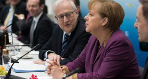 Chancellor Angela Merkel at a meeting of the liberal Free Democratic Party, which is seeking a relaxation of the dual citizenship rules. Photograph: Thomas Peter/Reuters
