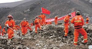 Rescuers search for survivors at the site of a landslide in a mining area in Maizhokunggar County, Tibet Autonomous Region. Photograph: Reuters