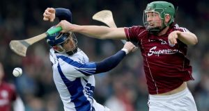 Waterford's Shane Fives and Niall Burke of Galway at Walsh Park. Photograph: James Crombie/Inpho